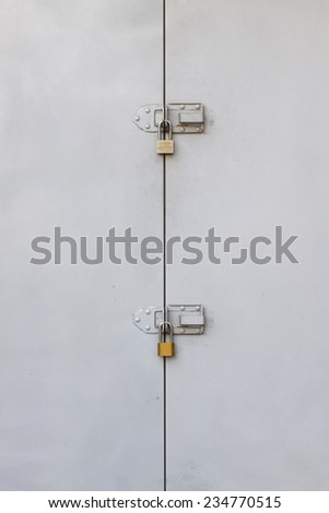 Background of door with lock in metal material, Security equipment. - stock photo