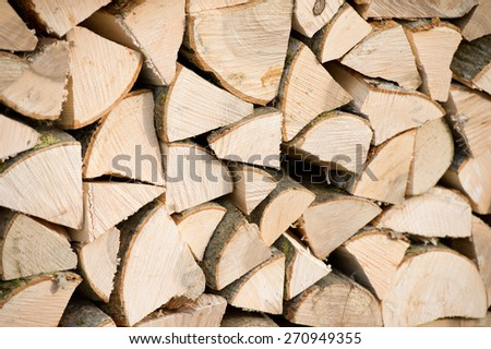 Background of dry chopped firewood logs in a pile - stock photo