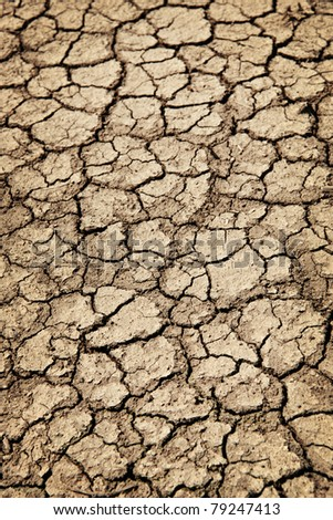 Background of dry cracked soil dirt or earth during drought - stock photo