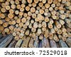 Background of dry eucalyptus chopped firewood logs stacked up on top of each other in a pile - stock photo