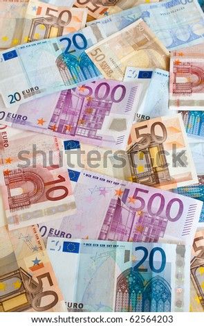 Background of euros: ten, twenty, fifty and five-hundred euro banknotes. - stock photo