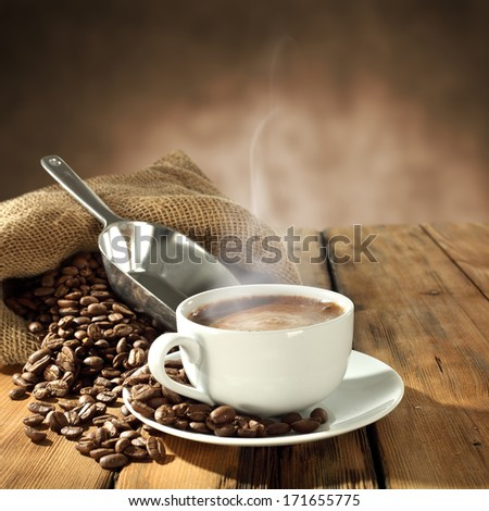 background of fresh coffee beans and warm cup  - stock photo