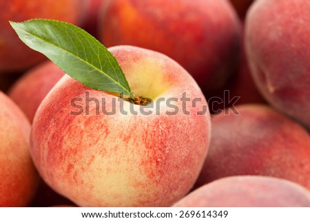 Background of fresh ripe peaches. With leaf. - stock photo