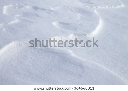 background of fresh snow texture in blue tone/pure white snow with blue tones/winter landscape - stock photo