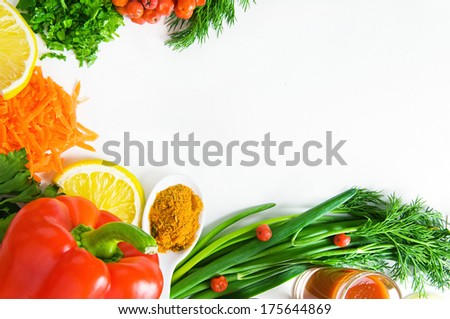 background of fresh vegetables on a white surface - stock photo
