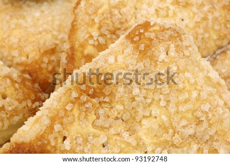 background of freshly baked sugared apricot turnovers