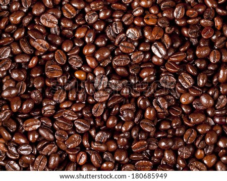Background of freshly dark roasted coffee beans - stock photo