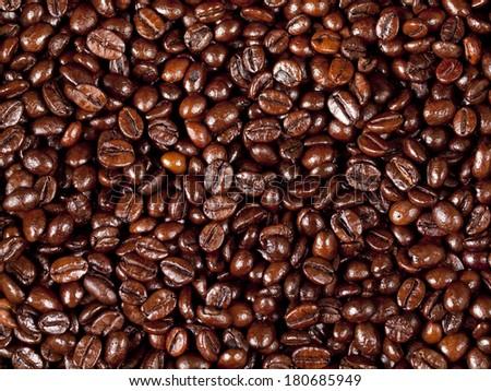 Background of freshly dark roasted coffee beans - stock photo