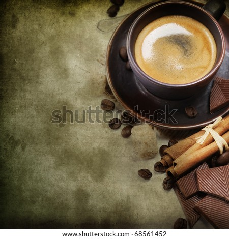 Background of freshly prepared cup of italian espresso with cinnamon, coffe beans, brown sugar and chocolate - stock photo