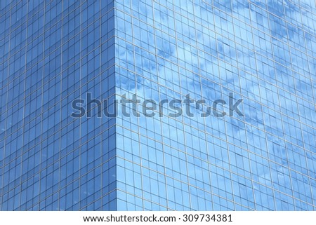 background of glass windows of modern office building - stock photo