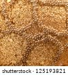 background of gold beads and sequins - stock photo
