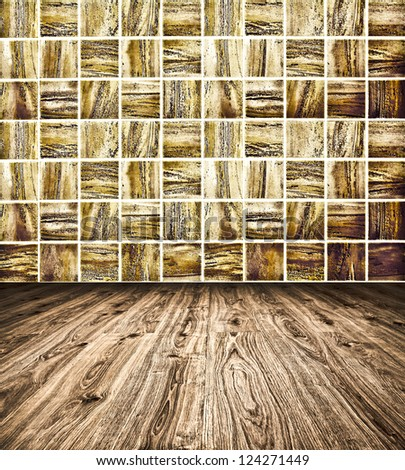 Background of Golden Mosaic Texture and wooden floor, spacious vintage room with stone and glass tiled grungy wall - stock photo