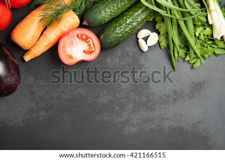 Background of graphite board black color with fresh vegetables.