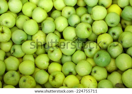background of green apples on sale at the local market - stock photo