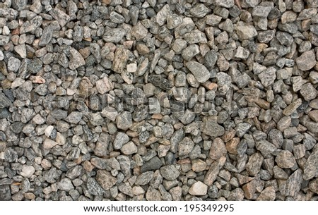Background of grey gneiss gravel - stock photo