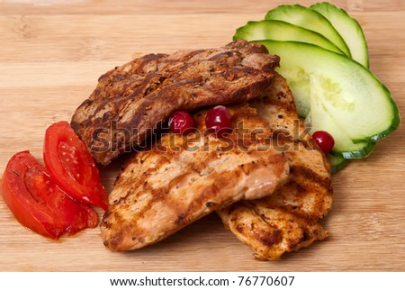 Background of grilled meat and vegetables on desk - stock photo