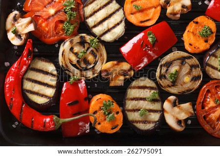 Background of grilled vegetables on a grill macro. horizontal view from above  - stock photo