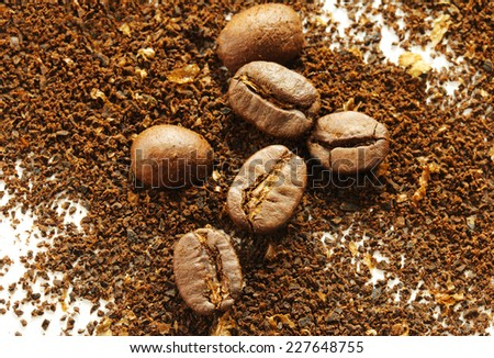 Background of ground coffee beans with coffe beans - stock photo