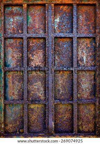 Background of grungy window with rusty iron bars and shutter plate  - stock photo