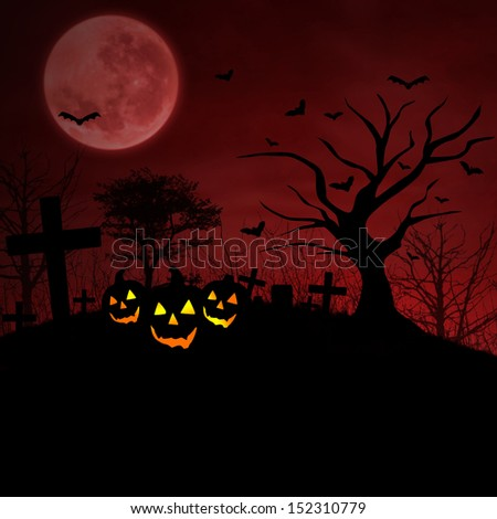 Background of halloween pumpkins on graveyard under red full moon - stock photo
