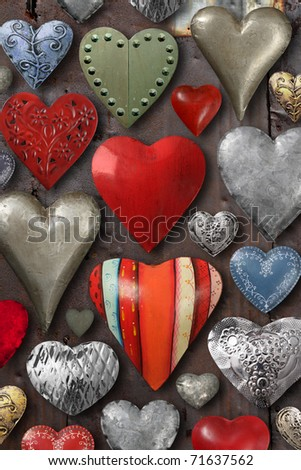 Background of heart-shaped things made of metal and steel. - stock photo