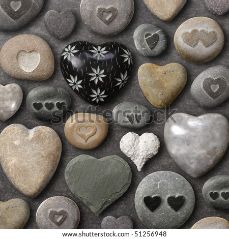 Background of heart-shaped things made of stone and rock. - stock photo