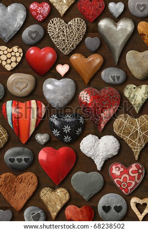 Background of heart-shaped things made of stone, metal and wood. - stock photo