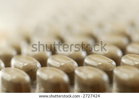 Background of herbal supplement pills close up - stock photo