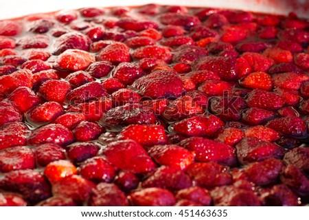 Background of homemade red strawberry jam - stock photo