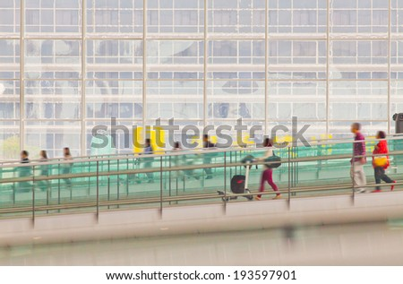 background of Hong Kong airport with travelers