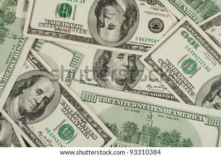 Background of hundred dollar bills laid out in a mess - stock photo
