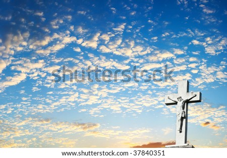 Background of Jesus Christ Crucifix with Clouds and Sunset in the Background - stock photo