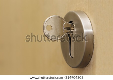 background of key in a keyhole - stock photo