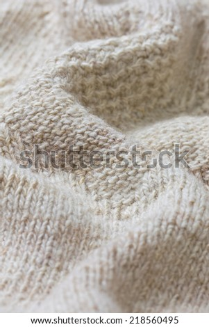 background of knitted fabric of wool yarn