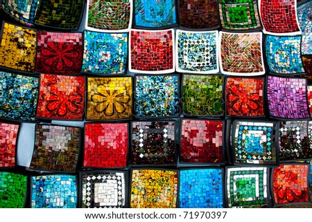 Background of lacquerware colorful plates - stock photo