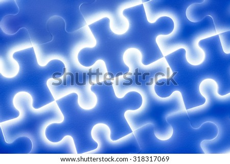 Background of large shining puzzles in blue