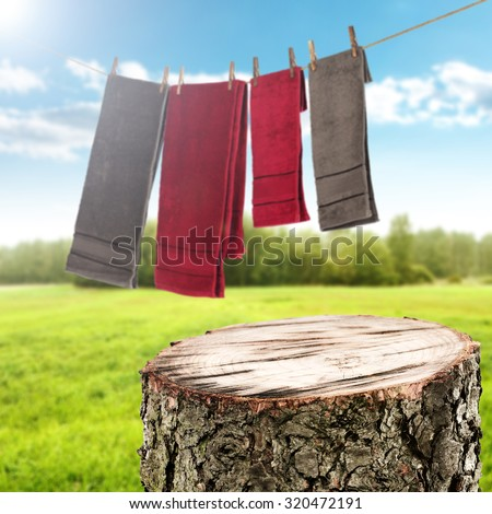 background of laundry on rope and towels of red and brown color  - stock photo