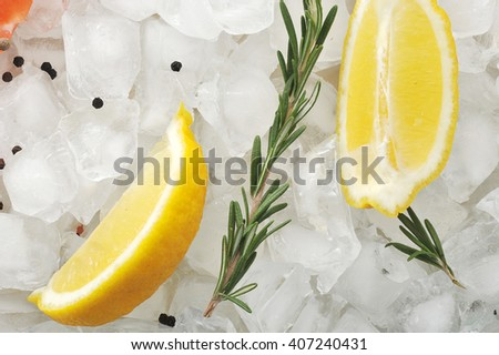 background of lemon slices and rosemary on the ice cubes. top view - stock photo