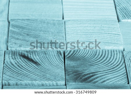 Background of light polished wooden cubes. Selective focus. Shallow depth of field. Toned. - stock photo