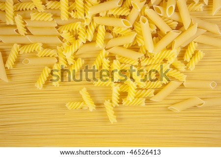 Background of Macaroni on long spaghetti. Close up .