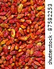 Background of many dried red chili peppers - stock photo