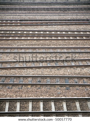 Background of many parallel railroad tracks in a yard - stock photo