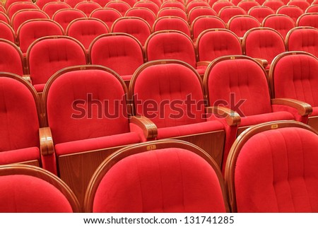 Background of many red theatrical red chairs - stock photo