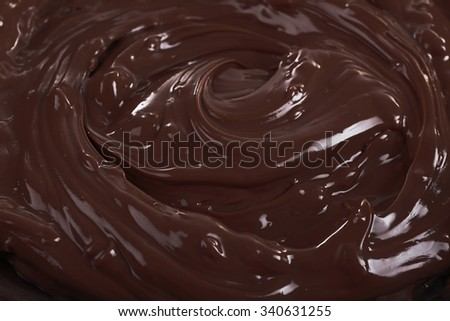 Background of melted milk chocolate, close-up - stock photo