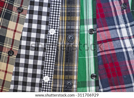 Background of men's chequered shirts - stock photo