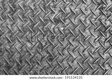 Background of metal diamond plate. - stock photo