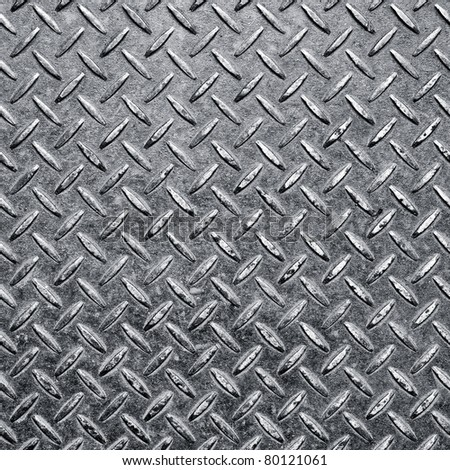 Background of metal diamond plate in silver color. - stock photo
