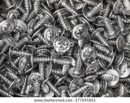 Background of metal screws - stock photo