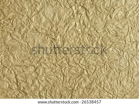 Background of metallic gold wrinkled rice paper - stock photo
