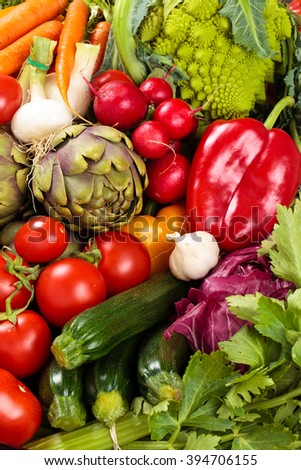 Background of mixed fresh organic vegetables and herbs. - stock photo